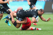 Jamie Roberts of Bath lis tackled by Lucas Pointud  of Toulouse een Bath Rugby and Toulouse at Recreation Ground on October 13, 2018 in Bath, United Kingdom.
