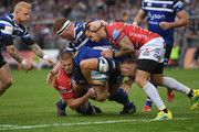 Gloucester player Danny Cipriani (r) cant stop Bath player Tom Dunn charging towards the line  during the Gallagher Premiership Rugby match between Bath Rugby and Gloucester Rugby at Recreation Ground on September 8, 2018 in Bath, United Kingdom.
