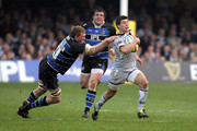 Ben Youngs of Leicester races clear of Stuart Hooper to set up a try for Toby Flood during the Aviva Premiership match between Bath and Leicester Tigers at the Recreation Ground on March 26, 2011 in Bath, England.