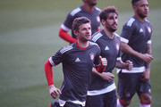 Thomas Mueller of Bayern Muenchen warms up during a training session prior to the UEFA Champions League Quarter-Final first leg match against Sevilla at Estadio Ramon Sanchez Pizjuan on April 2, 2018 in Seville, Spain.