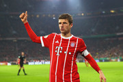 Thomas Mueller of FC Bayern Muenchen reacts during the DFB Cup match between Bayern Muenchen and Borussia Dortmund at Allianz Arena on December 20, 2017 in Munich, Germany.