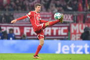 Thomas Mueller of Bayern Muenchen plays the ball during the DFB Cup match between Bayern Muenchen and Borussia Dortmund at Allianz Arena on December 20, 2017 in Munich, Germany.