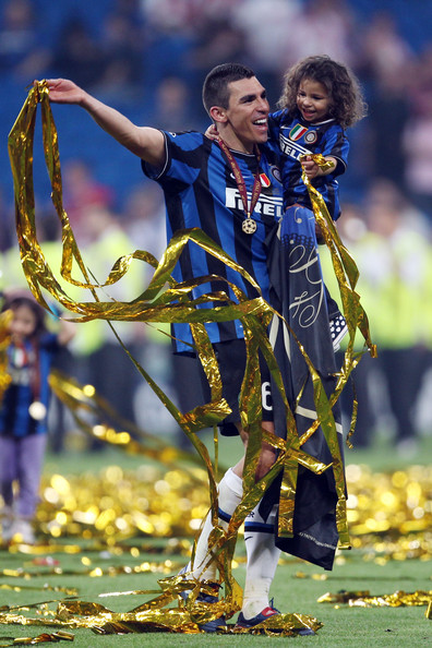 Lucio of Inter Milan and his family celebrate their team's victory at the end of the UEFA Champions League Final match between FC Bayern Muenchen and Inter Milan at the Estadio Santiago Bernabeu on May 22, 2010 in Madrid, Spain.