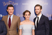 """(L-R) Luke Evans, Emma Watson and Dan Stevens attend the UK Launch Event of """"Beauty And The Beast"""" at Odeon Leicester Square on February 23, 2017 in London, England."""