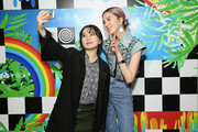 Irene Kim poses with fans during a Meet & Greet at Beautycon Festival NYC 2018 - Day 1 at Jacob Javits Center on April 21, 2018 in New York City.