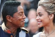 US singer Jermaine Jackson (L) and guest arrive on May 24, 2017 for the screening of the film 'The Beguiled' at the 70th edition of the Cannes Film Festival in Cannes, southern France.  / AFP PHOTO / Valery HACHE