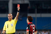Referee Andre Haddad (L) show the red card to Choi Hyo-Jin of Seoul FC during the AFC Champions League Round of 16 match between Beijing Guoan and Seoul FC at Beijing Workers' Stadium on May 14, 2013 in Beijing, China.