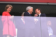 (L-R) Belgium's  Queen Mathilde, King Philippe, French President Emmanuel Macron attend the 2018 FIFA World Cup Russia Semi Final match between Belgium and France at Saint Petersburg Stadium on July 10, 2018 in Saint Petersburg, Russia.