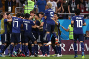Takashi Inui of Japan celebrates with teammates after scoring his team's second goal during the 2018 FIFA World Cup Russia Round of 16 match between Belgium and Japan at Rostov Arena on July 2, 2018 in Rostov-on-Don, Russia.