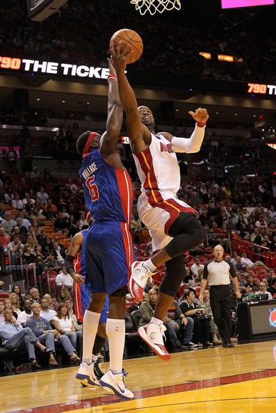 Detroit Pistons v Miami Heat [photograph,basketball,basketball moves,sports,basketball court,basketball player,team sport,ball game,player,sport venue,dwyane wade 3,user,user,note,basket,miami,miami heat,detroit pistons,game]