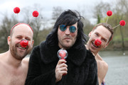 Benedict Cumberbatch (R) and Noel Fielding (C) and Zander Woollcombe (L) of United Global Mental Health support Red Nose Day by swimming in cold water for Mental Health programmes on March 15, 2019 in London, England.