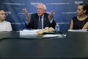 Democratic presidential candidate Sen. Bernie Sanders (I-VT) (C) participates in an internet live stream discussion about putting families first in developing immigration policy with Santos Guevera Amaya (L) and his Latino Outreach Strategist Erika Andiola at his campaign office December 7, 2015 in Washington, DC. Sanders heard from 'Dreamers,' undocumented immigrants who were brought to the United States by their parents when they were children, members of the immigrant LGBT community, and a former hunger striker, all of whom asked the senator to support immigration reform.