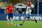 A pitch invader runs for the ball as Alexis Sanchez of Chile looks on during the Copa America Brazil 2019 group C match between Chile and Uruguay at Maracana Stadium on June 24, 2019 in Rio de Janeiro, Brazil.