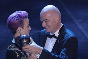Megan Rapinoe receives The Best FIFA Women's Player of the Year award by FIFA President Gianni Infantino during The Best FIFA Football Awards 2019 at Teatro alla Scala on September 23, 2019 in Milan, Italy.