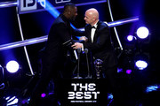 FIFA President, Gianni Infantino (R) shakes hands with Idris Elba during the The Best FIFA Football Awards Show at Royal Festival Hall on September 24, 2018 in London, England.