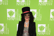 Joan Collins attends Bette Midler's Hulaween To Benefit NY Restoration Project at New York Midtown Hilton on October 31, 2019 in New York City.
