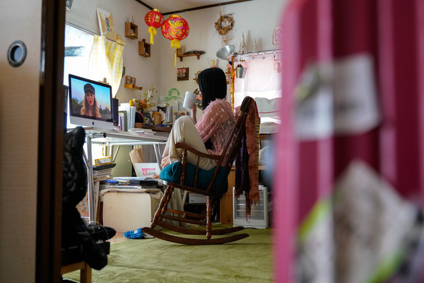 People Watch 'One World: Together At Home' In Tokyo