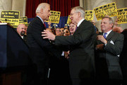 "U.S. Vice President Joseph Biden (L) is greeted by Senate Majority Leader Sen. Harry Reid (D-NV) (2nd R) as Senate Majority Whip Sen. Richard Durbin (D-IL) (R) and Sen. Debbie Stabenow (D-MI) (3rd R) look on during a rally October 19, 2011 on Capitol Hill in Washington, DC. Biden joined Senate Democratic leaders to hold a rally with fire fighters, police officers and teachers to call for the passage of S.1723, the ""Teachers and First Responders Back to Work Act."""