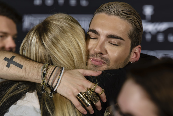 Tokio Hotel Press Conference  [interaction,arm,blond,facial hair,hand,photography,fashion accessory,beard,long hair,gesture,fan,bill kaulitz,photocall,record,berlin,germany,tokio hotel press conference,kings of suburbia,tokio hotel press conference photocall,break]