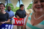 Bill Richardson, former Governor of New Mexico (C) speaks with people during a climate change rally on August 9, 2013 in Miami, Florida. The governor was joined by local elected officials and community advocates to highlight the impacts of extreme weather and climate change in South Florida and call for bold federal action on climate solutions.