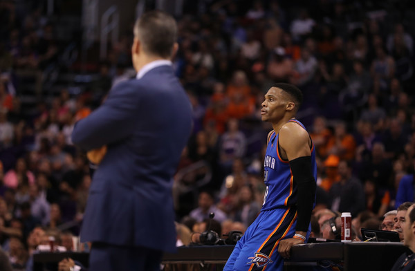 Oklahoma City Thunder v Phoenix Suns [photograph,fan,basketball player,audience,basketball moves,crowd,sport venue,basketball,championship,ball game,sports,billy donovan,russell westbrook,user,phoenix,talking stick resort arena,phoenix suns,oklahoma city thunder,game,half]