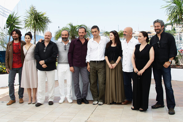 "(L-R) Gokhan Tirtaki, Nihan Okutucu, Ahmet Mumtaz Taylan, Yilmaz Erdogan, Muhammet Uzuner, Nuri Bilge Ceylan,  Ebru Ceylan, Ercan Kesal, Zeynep Ozbatur Atakan and Gokhan Tiryaki attend the ""Bir Zamanlar Anadolu'Da"" Photocall at Palais des Festivals during the 64th Annual Cannes Film Festival on May 21, 2011 in Cannes, France."