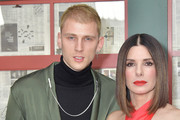 """Actors Colson Baker and Sandra Bullock attend the New York screening of """"Bird Box"""" at Alice Tully Hall, Lincoln Center on December 17, 2018 in New York City."""