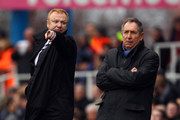 Birmingham manager Alex McLeish (L) and Villa manager Gerard Houllier (R) watch on from the touchline during the Barclays Premier League match between Birmingham City and Aston Villa at St.Andrews on January 16, 2011 in Birmingham, England.