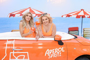 Victoria Brown  and (R) Tallia Storm attends the Aperol Spritz Big Birthday Social as Aperol celebrates 100 years at Electric Light Station on May 22, 2019 in London, England. The 100th birthday celebrations continue for the next two weeks with the event open until June 1st with walk in tickets available at the door every day.