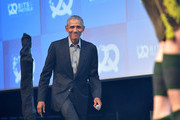 "Former U.S. President Barack Obama arrives at the opening of the Bits & Pretzels meetup on September 29, 2019 in Munich, Germany. The annual event brings together founders and startups from across the globe for three days of networking, talks and inspiration. during the ""Bits & Pretzels Founders Festival"" at ICM Munich on September 29, 2019 in Munich, Germany. Bits & Pretzels is an application-only, three-day festival that connects 5,000 founders, investors, startup enthusiasts,taking place from September 29 to October 1, 2019."