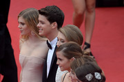 (L-R) Actors Claire Julien, Israel Broussard, Taissa Farmiga, Emma Watson, director Sofia Coppola and actress Katie Chang attend 'The Bling Ring' premiere during The 66th Annual Cannes Film Festival at the Palais des Festivals on May 16, 2013 in Cannes, France.