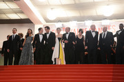 Actors Zoe Saldana, Billy Crudup, director Guillaume Canet, actors Clive Owen, Marion Cotillard, James Caan, Lily Taylor, Noah Emmerich, Domenick Lombardozzi, Jamie Hector and Mark Mahoney depart the 'Blood Ties' Premiere during the 66th Annual Cannes Film Festival at the Palais des Festivals on May 20, 2013 in Cannes, France.