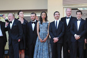 (L-R) Producer Christopher Woodrow, actors Zoe Saldana,  Billy Crudup and Noah Emmerich, director Guillaume Canet, actors Clive Owen, Marion Cotillard, Jamie Hector attend the 'Blood Ties' Premiere during the 66th Annual Cannes Film Festival at the Palais des Festivals on May 20, 2013 in Cannes, France.