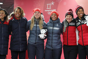 (L-R) Elana Meyers Taylor and Lauren Gibbs of the United States, silver, Lisa Buckwitz and Mariama Jamanka of Germany, gold, and Kaillie Humphries and Phylicia George of Canada, bronze, celebrate after the Women's Bobsleigh heats on day twelve of the PyeongChang 2018 Winter Olympic Games at the Olympic Sliding Centre on February 21, 2018 in Pyeongchang-gun, South Korea.