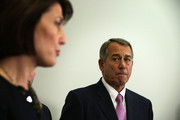 U.S. Speaker of the House Rep. John Boehner (R-OH) (R) listens as Rep. Cathy McMorris Rodgers (R-WA) (L) speaks during a news briefing after a House Republican Caucus meeting October 27, 2015 at the Capitol in Washington, DC. Congressional leaders had reached to an agreement with the White House to raise domestic and defense spending and lift the debt limit until March 2017.