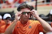 Head Coach Mike Gundy of the Oklahoma State Cowboys adjust his glasses before the game against the Boise State Broncos at Boone Pickens Stadium on September 15, 2018 in Stillwater, Oklahoma. The Cowboys defeated the Broncos 44-21.