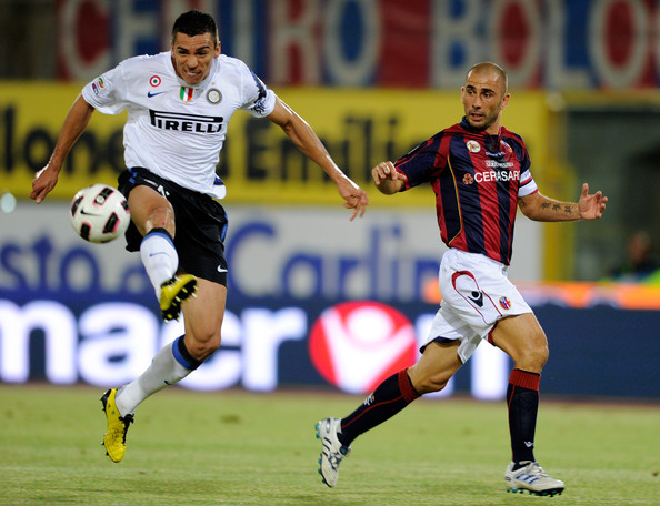 Lucio of FC Internazionale Milano and Marco Di Vaio of Bologna FC compete for the ball during the Serie A match between Bologna and Inter at Stadio Renato Dall'Ara on August 30, 2010 in Bologna, Italy.