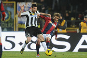 Alessandro Diamanti # 23 of Bologna FC ( R ) competes the ball with Andrea Lazzari # 21 of Udinese Calcio ( L ) during the Serie A match between Bologna FC and Udinese Calcio at Stadio Renato Dall'Ara on February 1, 2014 in Bologna, Italy.