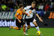 Stephen Hunt of Wolverhampton Wanderers tussles with Ivan Klasnic of Bolton Wanderers during the Barclays Premier League match between Bolton Wanderers and Wolverhampton Wanderers at the Reebok Stadium on December 31, 2011 in Bolton, England.