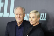 """John Lithgow and Charlize Theron attend the """"Bombshell"""" New York Screening at Jazz at Lincoln Center on December 16, 2019 in New York City."""
