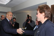 Musican Jon Bon Jovi (R) and City of Newark Mayor Cory Booker attend the opening of affordable housing funded through Bon Jovi's JBJ Soul Foundation on December 8, 2009 in Newark, New Jersey.
