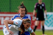 Jill Scott (L) of England competes for the ball against Alisa Spahic (R) of Bosnia during the UEFA Women's European Championship Qualifier match between Bosnia and Herzegovina and England at FF BIH Football Training Centre on April 12, 2016 in Zenica, Bosnia and Herzegovina.