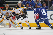 Charlie McAvoy #73 of the Boston Bruins skates against Tomas Plekanec #19 of the Toronto Maple Leafs in Game Three of the Eastern Conference First Round during the 2018 Stanley Cup Play-offs at the Air Canada Centre on April 16, 2018 in Toronto, Ontario, Canada. The Maple Leafs defeated the Bruins 4-2. (Photo by Claus Andersen/Getty Images) *** Local Caption *** Charlie McAvoy; Tomas Plekanec