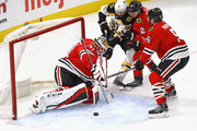 Anton Forsberg #31 of the Chicago Blackhawks makes a save against Rick Nash #61 of the Boston Bruins as Duncan Keith #2 and Connor Murphy #5 defend at the United Center on March 11, 2018 in Chicago, Illinois. The Blackhawks defeated the Bruins 3-1.
