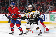 Andrei Markov #79 of the Montreal Canadiens battles for position against David Krejci #46 of the Boston Bruins in Game Three of the Second Round of the 2014 NHL Stanley Cup Playoffs at the Bell Centre on May 6, 2014 in Montreal, Quebec, Canada.