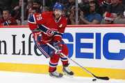 Andrei Markov #79 of the Montreal Canadiens skates with the puck in Game Three of the Second Round of the 2014 NHL Stanley Cup Playoffs against the Boston Bruins at the Bell Centre on May 6, 2014 in Montreal, Quebec, Canada.