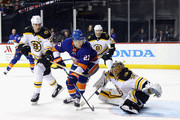 Zdeno Chara #33 and Anton Khudobin #35 of the Boston Bruins defend against Anders Lee #27 of the New York Islanders during the second period at the Barclays Center on January 18, 2018 in the Brooklyn borough of New York City.