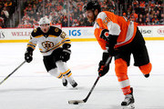Claude Giroux #28 of the Philadelphia Flyers takes a shot and gets the puck in the nets as Brad Marchand #63 of the Boston Bruins defends in the second period on December 02, 2017 at Wells Fargo Center in Philadelphia, Pennsylvania.The goal was called back after it was determined that Wayne Simmonds #17 of the Philadelphia Flyers was called for goaltender interference.