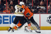 Pierre-Edouard Bellemare #78 of the Philadelphia Flyers is checked by Patrice Bergeron #37 of the Boston Bruins during the first period at the Wells Fargo Center on January 13, 2016 in Philadelphia, Pennsylvania.