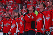 Alex Ovechkin #8 of the Washington Capitals watches a highlight video with teammates before their 2018 Stanley Cup Championship banner rises to the rafters before playing against the Boston Bruins at Capital One Arena on October 3, 2018 in Washington, DC.